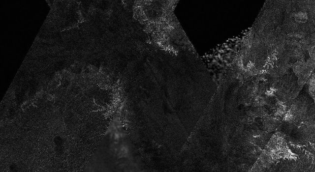 This mosaic of image swaths from NASA's Cassini's Titan Radar Mapper, taken with the synthetic-aperture radar, features a large dark region several hundred kilometers across that differs in several significant ways from potential lakes observed on Titan.