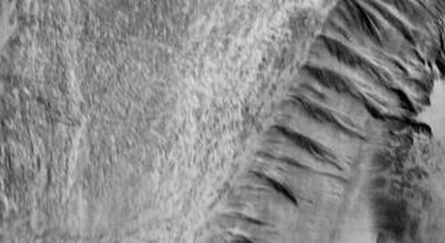 NASA's 2001 Mars Odyssey image shows part of Ophir Chasma. Note the landslide deposits near the top of the image.