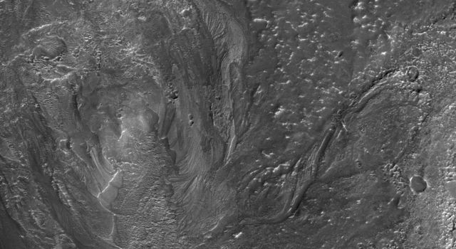 This image from NASA's Mars Reconnaissance Orbiter, shows channels to the southeast of Hale crater on southern Mars. Channels associated with impact craters were once thought to be quite rare.