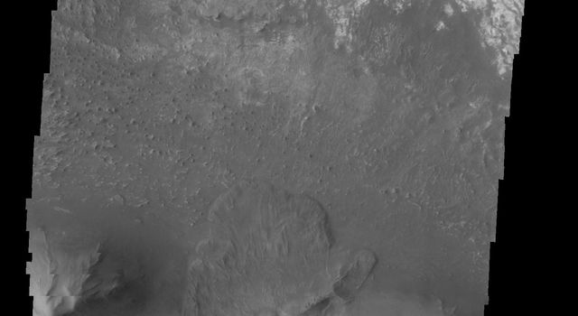 This image taken by NASA's 2001 Mars Odyssey spacecraft shows a landslide deposit on the southern rim of Candor Chasma.