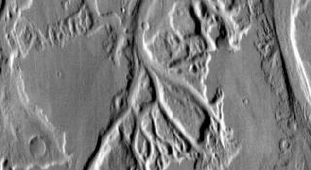 This daytime infrared image taken by NASA's 2001 Mars Odyssey spacecraft shows the numerous small channels that comprise Mangala Valles.