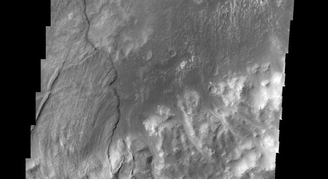 This image, taken by NASA's 2001 Mars Odyssey spacecraft, shows a large landslide deposit in an unnamed crater southwest of Holden Crater.