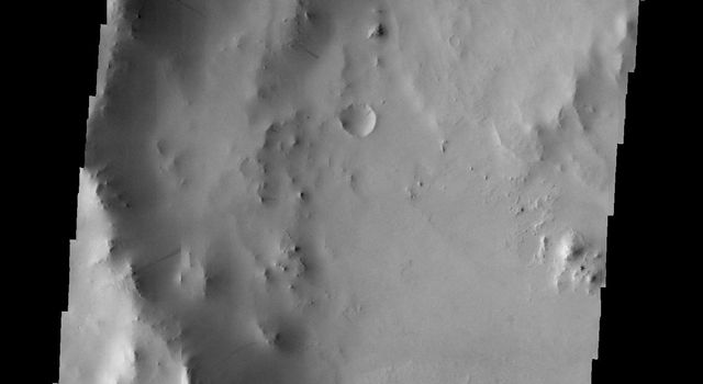 Many dark slope streaks are visible in this image of an unnamed crater in Terra Sabaea taken by NASA's 2001 Mars Odyssey spacecraft.