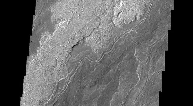This image, taken by NASA's 2001 Mars Odyssey spacecraft, shows a portion of the lava flows associated with Arsia Mons.