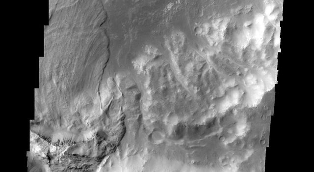 Only a portion of a large landslide deposit is shown in this image taken by NASA's 2001 Mars Odyssey spacecraft. The landslide occurred on the rim of an unnamed crater southwest of Holden Crater.