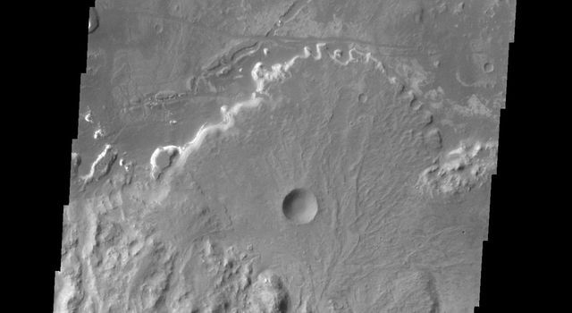 Taken by NASA's 2001 Mars Odyssey spacecraft, this image shows a fan shaped deposit located on the floor of Holden Crater.
