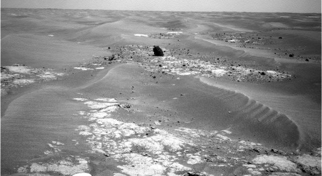 NASA's Mars Exploration Rover Opportunity took this picture of a rock informally named 'Marquette Island' as the rover was approaching the rock for investigations that have suggested the rock is a stony meteorite.