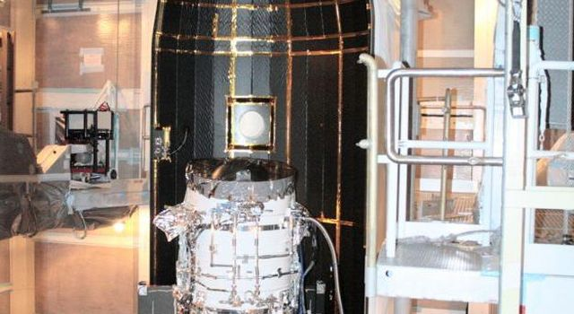 NASA's Wide-field Infrared Survey Explorer is shown inside one-half of the nose cone, or fairing, that will protect it during launch.