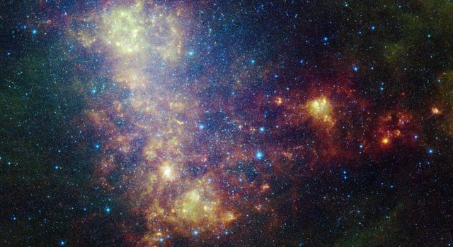 This infrared portrait of the Small Magellanic Cloud, taken by NASA's Spitzer Space Telescope, reveals the stars and dust in this galaxy as never seen before. This nearby satellite galaxy to our Milky Way galaxy is some 200,000 light-years away.