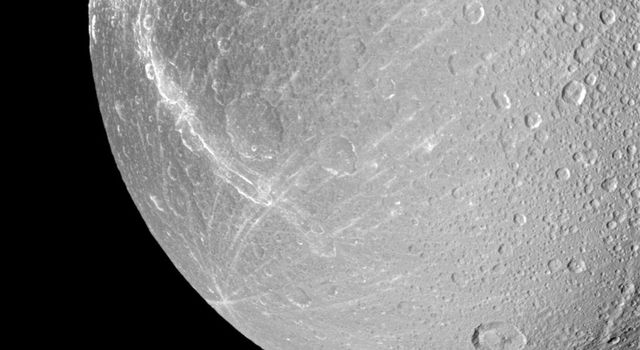 Wispy terrain winds across the trailing hemisphere of Saturn's moon Dione in this view taken during NASA's Cassini spacecraft's Jan. 27, 2010 non-targeted flyby.