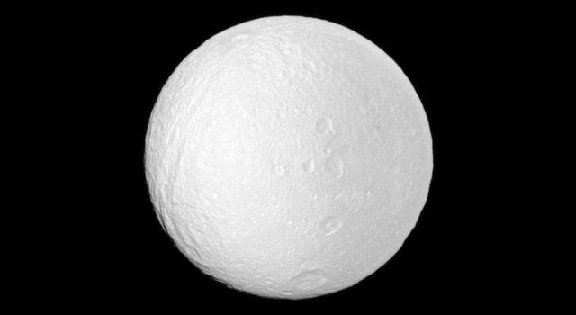 NASA's Cassini spacecraft profiles several features oriented north-south on Saturn's moon Tethys. A line of craters runs north to south near the center of the image: (from top) Phemius, Polyphemus, Ajax and the large southern crater Antinous.