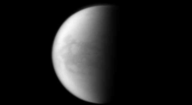 NASA's Cassini spacecraft looks toward Saturn's largest moon and maps the dark Belet region on Titan.