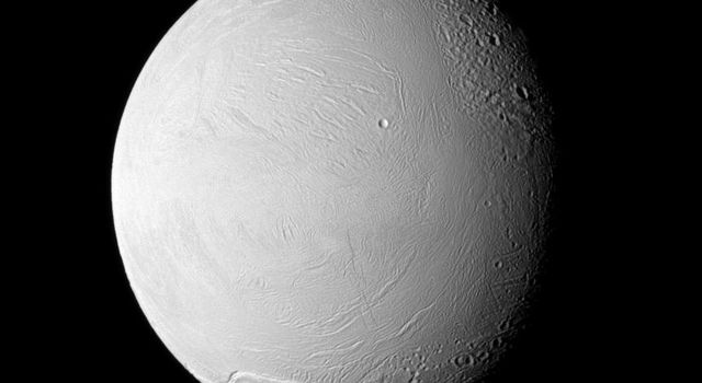 NASA's Cassini spacecraft examines old and new terrain on Saturn's fascinating Enceladus, a moon where jets of water ice particles and vapor spew from the south pole. Newly created terrain is at the bottom, in the center and on the left of this view.
