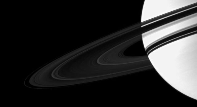 Saturn is overexposed in this image taken by NASA's Cassini spacecraft in order to show the dim rings. Pandora (below rings to the left) has been brightened by a factor of 1.3 relative to the planet and the rings to enhance its visibility.