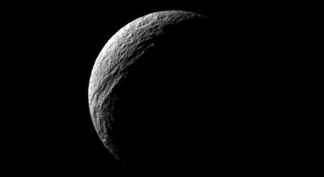 Sunlight illuminates the deep cut of Ithaca Chasma on Saturn's moon Tethys. Ithaca Chasma runs roughly north-south for more than 1,000 kilometers (620 miles) on Tethys in this image captured by NASA's Cassini spacecraft.