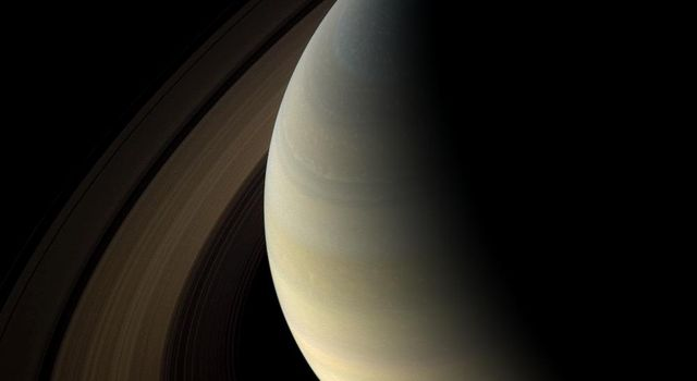 The shadows of Saturn's rings cast onto the planet appear as a thin band at the equator in this image taken by NASA's Cassini spacecraft as the planet approached its August 2009 equinox.