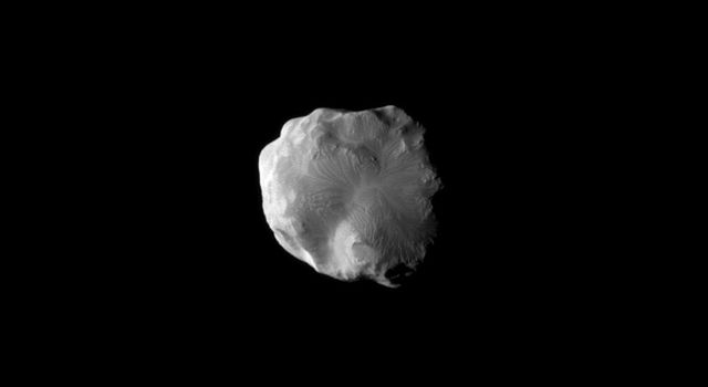 NASA's Cassini spacecraft imaged the surface of Saturn's moon Helene as the it flew by the moon on Jan. 31, 2011. Helene is a 'Trojan' moon of Dione, named for the Trojan asteroids that orbit 60 degrees ahead of and behind Jupiter as it circles the Sun.