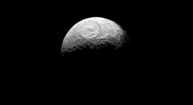 NASA's Cassini spacecraft takes one of its last good looks at Iapetus, a Saturnian moon known for its yin-yang-like, bright-and-dark color pattern.