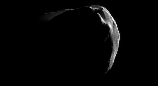 Saturn's small, irregularly shaped moon Helene is strikingly illuminated in this close view captured by NASA's Cassini during the spacecraft's June 18, 2011, flyby.