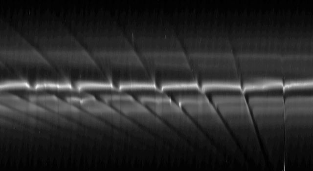 This mosaic of images from NASA's Cassini spacecraft depicts fan-like structures in Saturn's tenuous F ring. Bright features are also visible near the core of the ring. Such features suggest the existence of additional objects in the F ring.