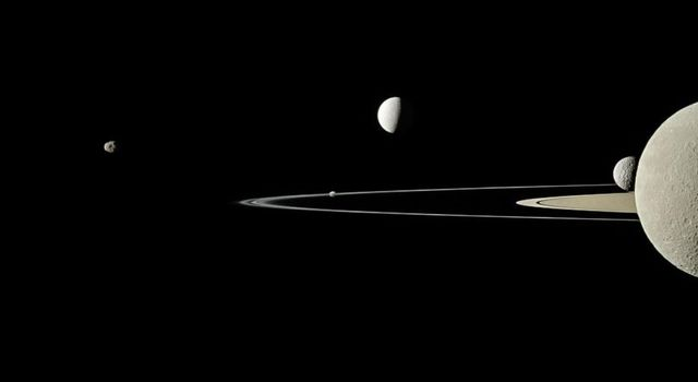This image from NASA's Cassini spacecraft captured five of Saturn's moons. Moons visible in this view: Janus; Pandora; Enceladus, Mimas & Saturn's second largest moon, Rhea.