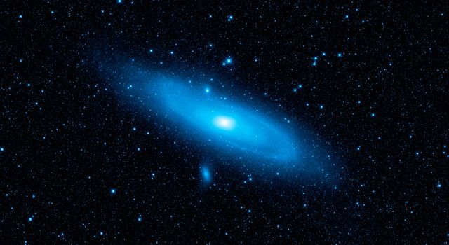 This image from NASA's Wide-field Infrared Survey Explorer highlights the Andromeda galaxy's older stellar population in blue. A pronounced warp in the disk of the galaxy, the aftermath of a collision with another galaxy, can be seen in the spiral arm.