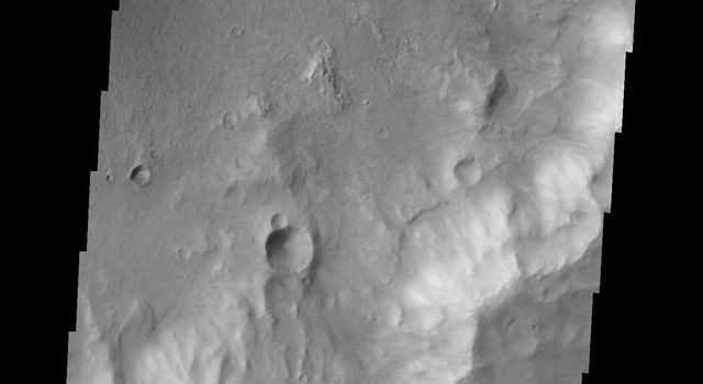 A sand dune field is located on the floor of this unnamed crater in Terra Cimmeria by NASA's 2001 Mars Odyssey spacecraft.