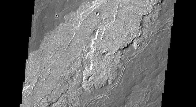 The lava flows in this image taken by NASA's 2001 Mars Odyssey spacecraft are part of the extensive flow field of Arsia Mons.