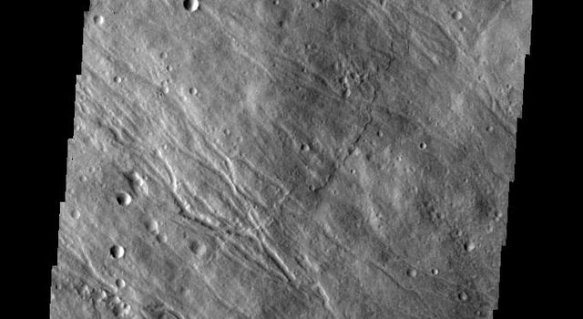 This image taken by NASA's 2001 Mars Odyssey shows the southeastern flank of Hecates Tholus, the northernmost volcano of the Elysium Volcanic complex.
