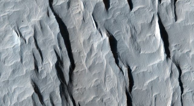 This image taken by NASA's Mars Reconnaissance Orbiter shows a part of a central mound in an impact crater in Arabia Terra.