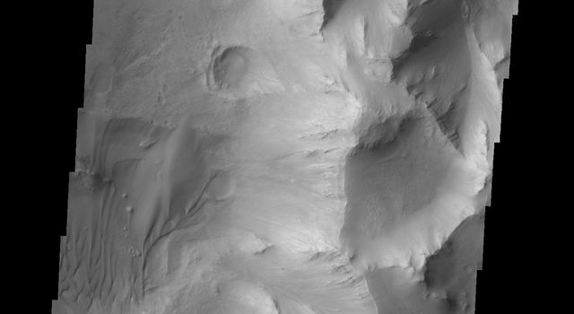This image from NASA's 2001 Mars Odyssey shows a portion of Capri Chasma. Dunes are found on the floor of this chasma.