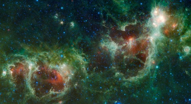 NASA's Wide-field Infrared Survey Explorer has captured a huge mosaic of two bubbling clouds in space, known as the Heart and Soul nebulae.