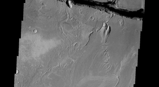This image captured by NASA's 2001 Mars Odyssey shows a small portion of the large fracture called Cerberus Fossae.