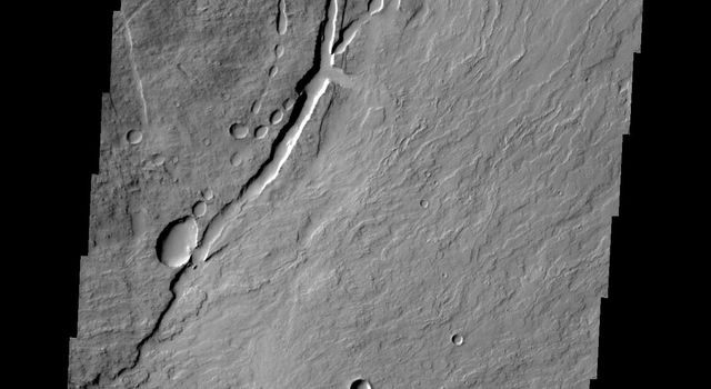 This image from NASA's 2001 Mars Odyssey shows the eastern flank of Pavonis Mons.