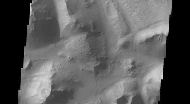 At eastern end of Valles Marineris is Eos Chasma. In Eos, the canyon system transitions into a region of chaos and then into major outflow channels. This image from NASA's 2001 Mars Odyssey shows the transition into chaos.