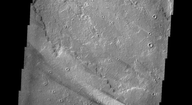 The windstreak in this image from NASA's 2001 Mars Odyssey is located on lava flows from Arsia Mons.