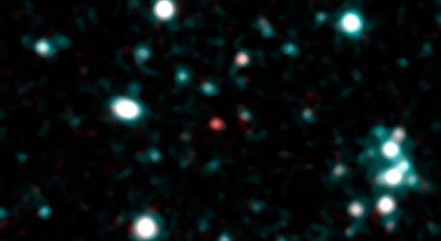 This image from NASA's Spitzer Space Telescope using infrared light shows what astronomers think is one of the coldest brown dwarfs discovered so far (red dot in middle of frame).