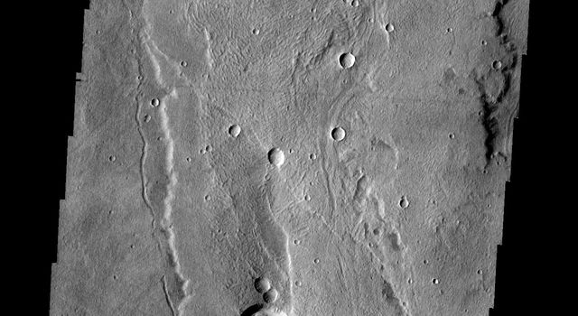 This image from NASA's 2001 Mars Odyssey image shows a small portion of the southern flank of Alba Mons.