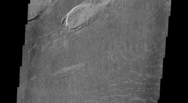 Marte Vallis is a lava channel. The image from NASA's 2001 Mars Odyssey shows the darker lava of Marte Vallis within the brighter surrounding materials. Platy flow texture is common in Marte Vallis.