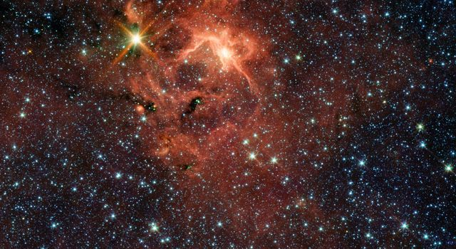 This star-forming region, captured by NASA's Spitzer Space Telescope, is dominated by the bright, young star IRAS 13481-6124; it is the first massive baby star for which astronomers could obtain a detailed look at the dusty disk closely encircling it.