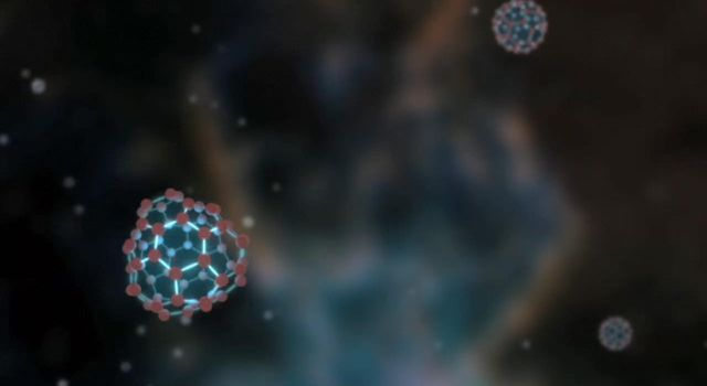 This artist's image illustrates vibrating buckyballs -- spherical molecules of carbon discovered in space for the first time by NASA's Spitzer Space Telescope.