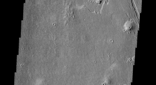 This wind eroded crater is located between Eumenides and Gordii Dorsa. The ejecta of the crater is more resistant to the wind than the surrounding materials in this image from NASA's Mars Odyssey.