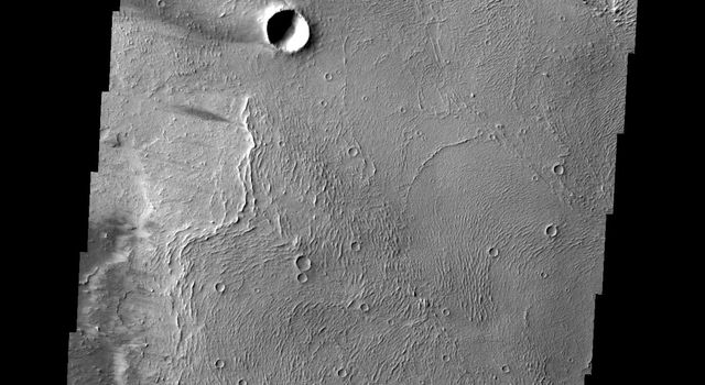 The windstreaks in this image captured by NASA's Mars Odyssey are located on lava flows from Arsia Mons.