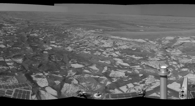 "This panorama taken by NASA's Mars Exploration Rover Opportunity includes an outcrop informally called ""Cambridge Bay."" Opportunity examined this outcrop in August 2010."