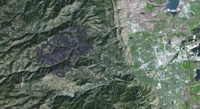 The Advanced Spaceborne Thermal Emission and Reflection Radiometer (ASTER) instrument aboard NASA's Terra spacecraft captured this image of the Fourmile Canyon fire west of Boulder Colo., on Sept. 17, 2010; it was 100 percent contained.