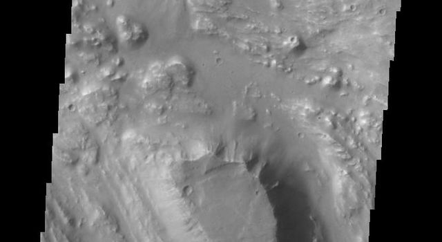 Located at the eastern end of Vallis Marineris is the region of chaos called Aurorae. This image from NASA's Mars Odyssey is from the northern part of Aurorae Chaos and contains mesas separated by complex low lying regions.