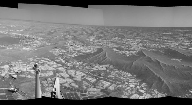 This mosaic of images from the navigation camera on NASA's Mars Exploration Rover Opportunity shows surroundings of the rover's location following a drive on Sept. 16, 2010. The terrain includes light-toned bedrock and darker ripples of wind-blown sand.