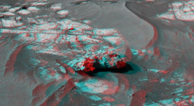 An iron meteorite is the latest quarry for NASA's Mars Exploration Rover Opportunity. Shown here is the left-eye view of a stereo pair of images. The anaglyph can be viewed at the Photojournal.