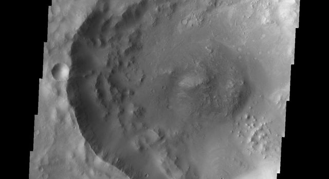 This image from NASA's Mars Odyssey shows a small channel entering the south side of Balvicar Crater.