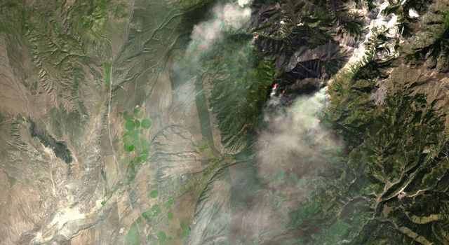 NASA's Terra spacecraft captured this image of the Twitchell Canyon fire, a lightning-caused blaze burning in Utah, which has consumed more than 40,000 acres since it began on July 20, 2010.